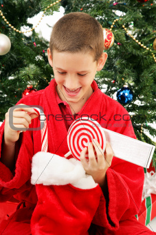 Little Boy Opening Christmas Stocking