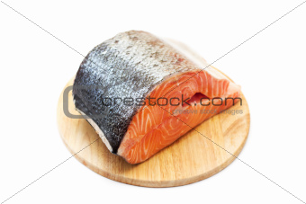 Fresh salmon on a round cutting board