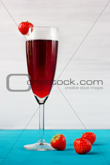 Strawberry wine or juice with berries
