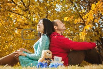 Young asian couple in love and having some autumn fun