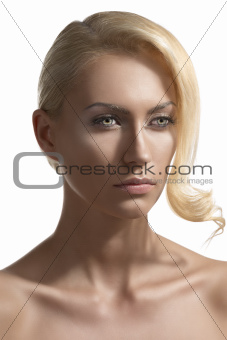 beauty portrait of blonde girl turned of three quarters