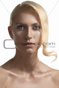 beauty portrait of blonde girl she is in front of the camera