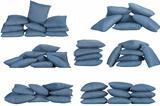seven stacks of blue denim pillows