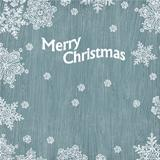 Christmas greetings with snowflakes on wooden texture. Vector il