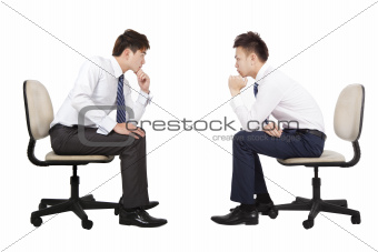 two businessman thinking and looking each other