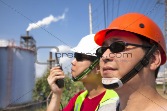 close up of  two asian refinery workers