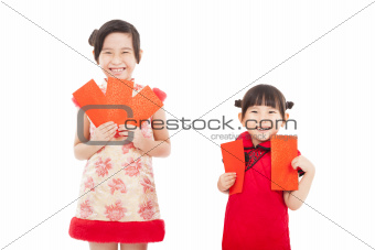 happy chinese new year. smiling asian little girls holding red e
