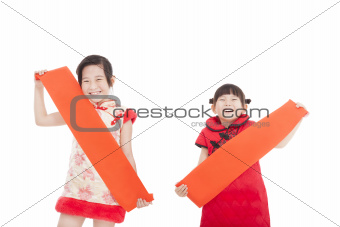two chinese little girl holding blank red couplets