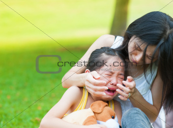 Crying little Asian girl