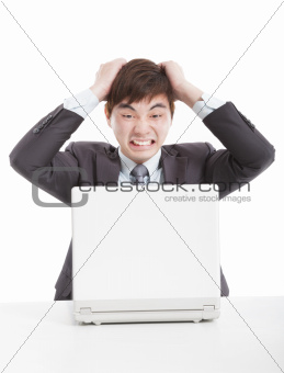 frustrated businessman with a laptop