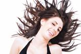 Laughing carefree woman l tossing her hair