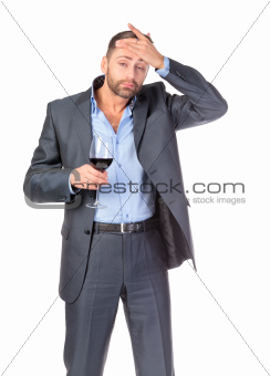 Portrait of thoughtful business man with glass wine