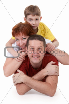 Mom and Dad and son lying on a white background
