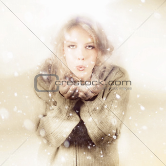 Beautiful Young Woman Blowing Snow In Winter Style