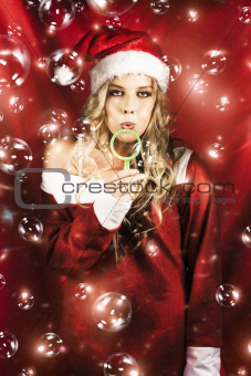 Attractive Christmas Woman Blowing Magic Bubbles