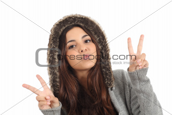 Teen girl with the fingers in victory sign