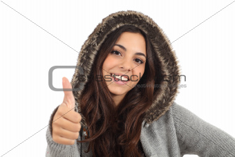 Teen girl with thumb up and smiling