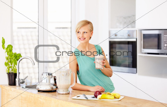 Relaxing in the kitchen with a smoothie