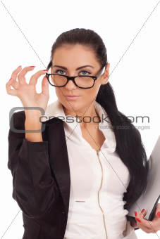 Portrait of young woman looking over glasses