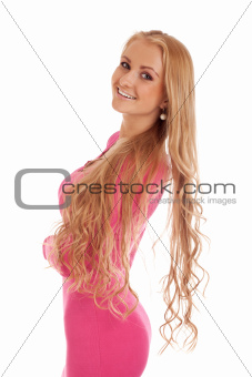 Beautiful blond woman in pink dress