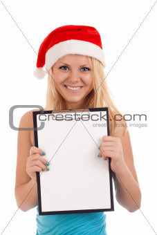 Young woman in santa hat holding blank board