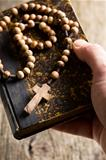 holy bible and rosary beads