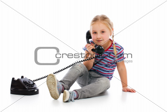 Little girl with old retro phone.