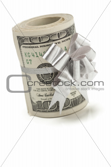 Roll of One Hundred Dollar Bills Tied in a Silver Bow on a White Background.