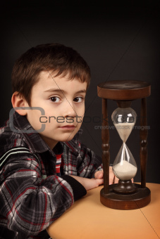 schoolboy with hour-glass