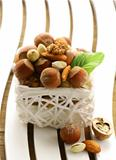 mix nuts - walnuts, hazelnuts, almonds in a white basket