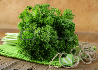 Fresh green, organic parsley on wooden table