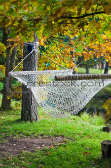 A hammock near the pond in autumn Park