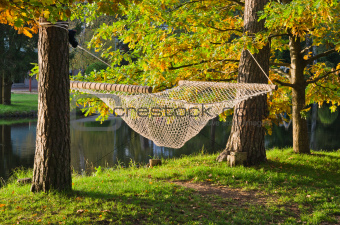 A hammock near the pond in autumn Park