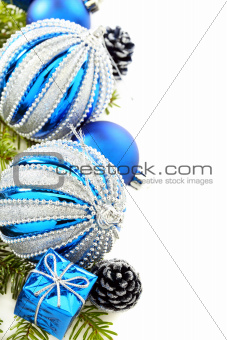 Christmas card with blue balls and cones.