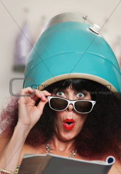 Woman Reading Under Hair Dryer