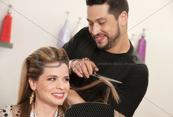 Attractive Woman Getting Haircut