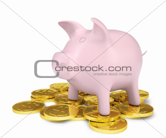 Pink piggy bank standing on a pile of coins with gold