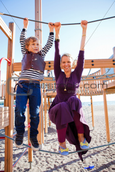 Mother and son playing at playground.