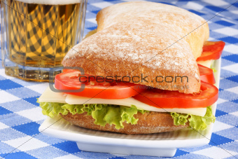Italian panino sandwich and beer