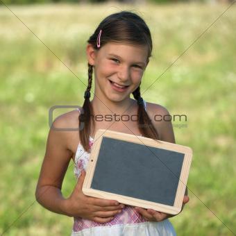 Girl holding a small blackboard