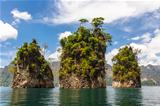 Three rocks in Cheow Lan Lake, Khao Sok National Park, Thailand.