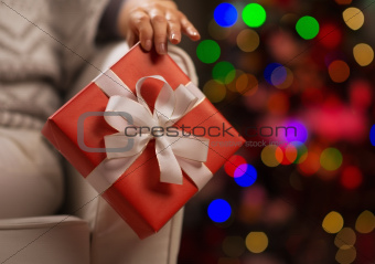 Closeup on Christmas present box in woman hand
