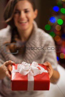 Closeup on Christmas gift box in woman hands