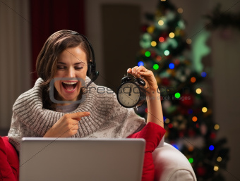 Happy young woman having video chat with family at New Year time