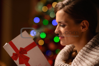 Young woman reading Christmas postcard