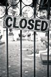 Monochrome closed sign on metal bars