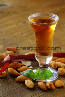 Almond liquor amaretto with whole nuts