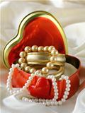 gift box with gold and pearl jewelry