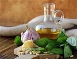ingredients for pesto, basil, olive oil, pine nuts, garlic and parmesan