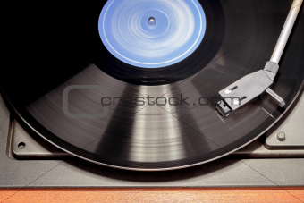 Vintage record player with spinning vinyl. Motion blur image.